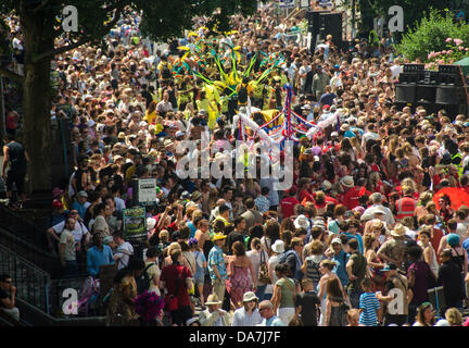 City Road, Bristol, UK. 6th July, 2013. Procession and spectators at the St Paul's Carnival in Bristol. Credit: - Stock Photo