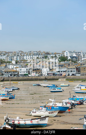 St. Ives Harbor at low tide on a bright June day. - Stock Photo