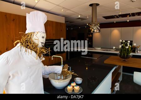 Kitchen showroom with straw stuffed Chef & chef's trousers, chef's aprons, chef's tunics, chef's jackets, chef hats, - Stock Photo