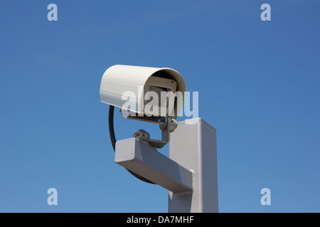 Modern outdoor surveillance camera facing right. - Stock Photo
