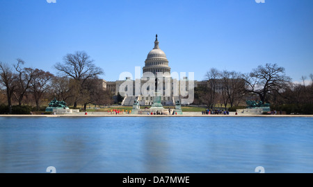The US Capitol building and the Ulysses S Grant Memorial in Washington, DC, as viewed from across the reflecting - Stock Photo