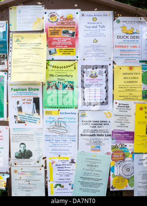 Community notice board in Sidmouth, Devon, England - Stock Photo