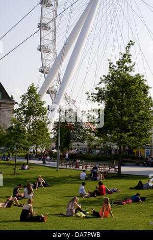 London, UK. 6th July, 2013. Sunny day in near the London eye on the southbank in  London Credit:  Jay Shaw-Baker/Alamy - Stock Photo