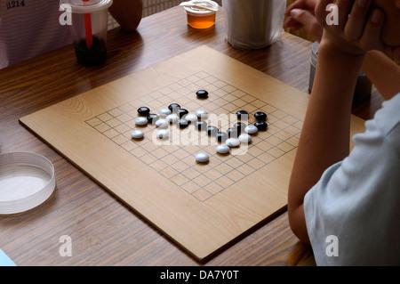 Children  playing chess - Stock Photo