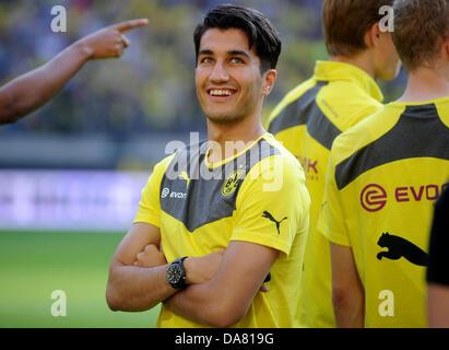 Dortmund, Germany. 6th July, 2013. Dortmund's Nuri Sahin smiles prior to the test match between Bundesliga soccer - Stock Photo