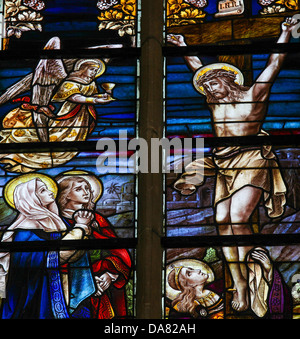 Stained Glass window depicting Jesus on the cross - Stock Photo