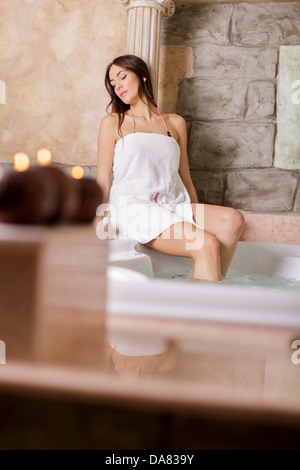 Young woman in hot tub - Stock Photo