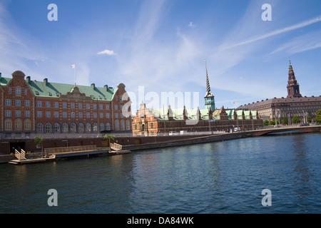 Copenhagen Denmark EU View across canal to Old Stock Exchange Building Borsen and Christiansborg Palace on islet - Stock Photo