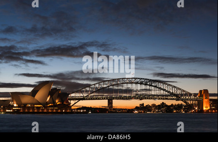 The Sydney Opera House and Harbour Bridge at dusk, on April 4, 2009. (Adrien Veczan) - Stock Photo
