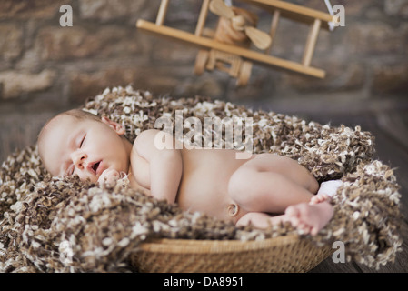 Fine picture of cute baby sleeping in toy room - Stock Photo