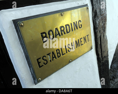 An old brass sign of an official boarding establishment IE an hotel or B&B ( bed and breakfast ) in Dorchester on - Stock Photo