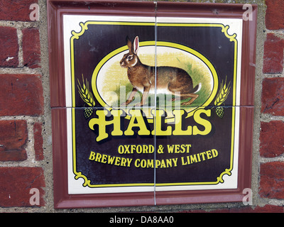 Halls Oxford & west Brewery Co Ltd Tiled Sign on an old pub exterior, now a house in High st, Dorchester on Thames - Stock Photo