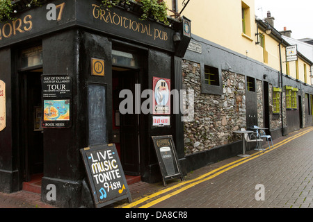 A pub that sells tours downtown in the streets of Killarney town in Co Kerry Republic of Ireland - Stock Photo