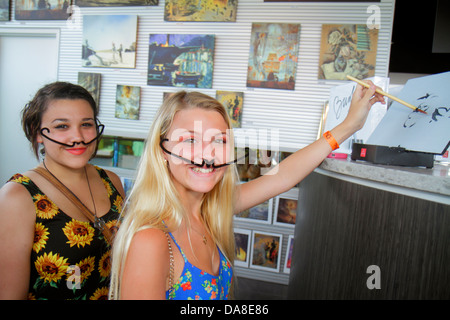 St. Saint Petersburg Florida Salvador Dali Museum gift store shopping teen girl pipe cleaner mustache - Stock Photo