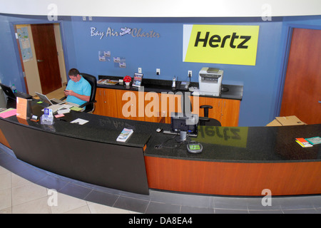 St. Saint Petersburg Florida Albert Whitted Airport SPG Hertz rental car counter - Stock Photo
