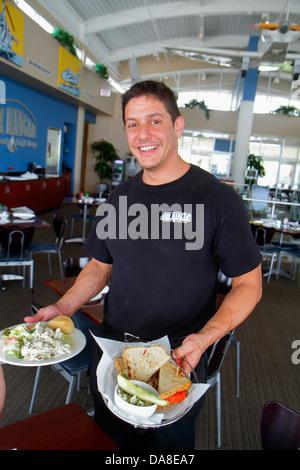 St. Saint Petersburg Florida Albert Whitted Airport SPG The Hangar restaurant man waiter serving job order food - Stock Photo