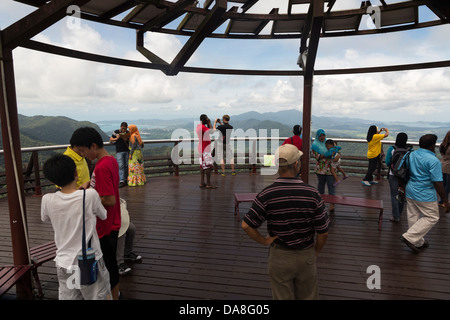 Tourists enjoying the view from the  viewing platform in Langkawi, the main resort island in Malaysia - Stock Photo