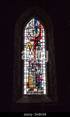 Stained Glass window in Parish Church of St.Mary the Virgin, Lindisfarne, Holy Island, Northumberland, England - Stock Photo