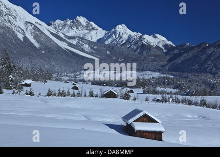 Austria, Europe, Tyrol, Gurgltal, Nassereith, winter, snow, Stadel, hay barn, wood, forest, mountains, Mieminger - Stock Photo