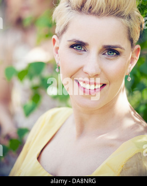 Cheerful blonde lady with cute smile - Stock Photo