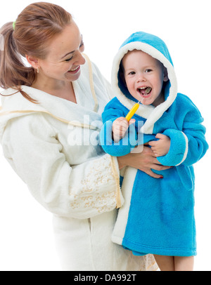Happy mother and child teeth brushing together in bathroom - Stock Photo