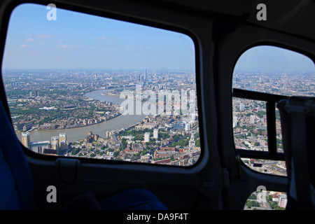 aerial view of The Thames, London through a helicopter window - Stock Photo