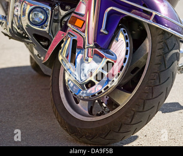Wheel of blue with red strips motorcycle, power symbol - Stock Photo