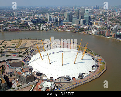 aerial view of the O2 Arena, Millennium Dome, London with Canary Wharf in the background - Stock Photo