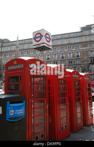 A row of red telephone boxes outside Charing Cross railway station in London - Stock Photo
