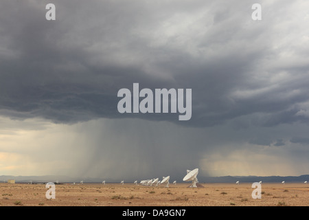Dramatic rainstorm over the Very Large Array Radio Telescope Satellite Network of the NRAO near Socorro New Mexico, - Stock Photo