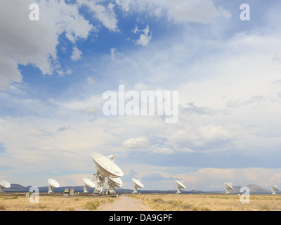 Sun shines brightly on the parabolic radio telescope dishes at the Very Large array near Socorro, New Mexico, USA - Stock Photo