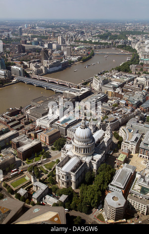 aerial view of St Paul's Cathedral looking west down The Thames towards the Houses of Parliament - Stock Photo