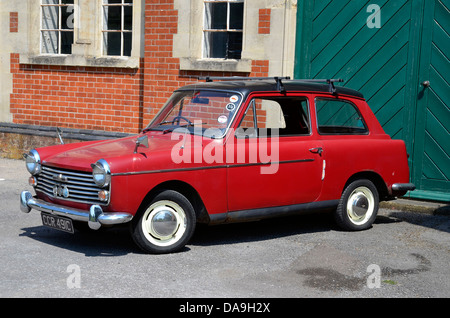 Red Austin A40 Farina Mk 2saloon car from approximately 1964-1965 and made by the British Motor Corporation. - Stock Photo