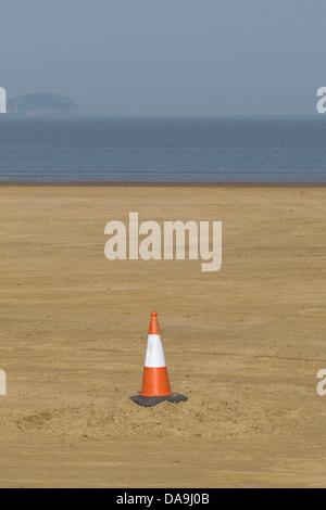 Traffic Cone on a sandy Beach - Stock Photo