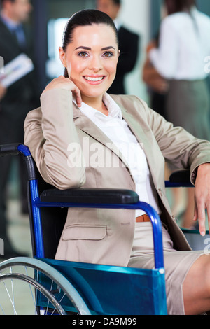 optimistic handicapped young woman in modern business world - Stock Photo