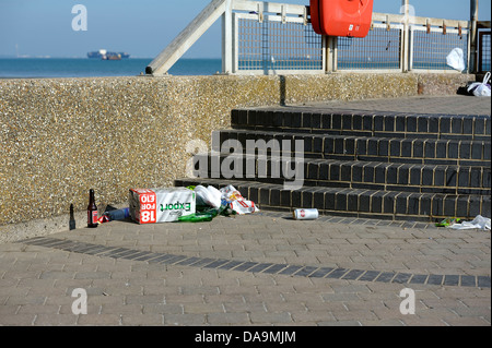 Rubbish left lying on streets of  coastal town  of ryde iow including empty beer bottles and cans after an evening - Stock Photo