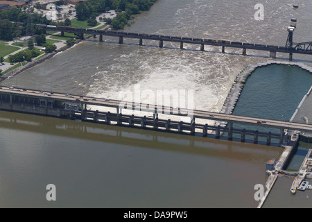 Aerial view of the Chickamauga dam and a railroad bridge, looking south.  The Tennessee River is at flood stage. - Stock Photo