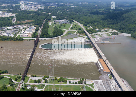 Aerial view of the Chickamauga dam and a railroad bridge, looking northwest.  The Tennessee River is at flood stage. - Stock Photo