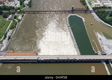 Aerial view of the Chickamauga dam and a railroad bridge, looking southwest.  The Tennessee River is at flood stage. - Stock Photo