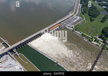 Aerial view of the Chickamauga dam and a railroad bridge, looking east.  The Tennessee River is at flood stage. - Stock Photo