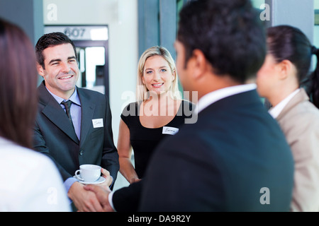 group of business people at business conference - Stock Photo
