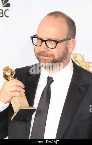 US actor and producer Paul Giamatti holds up his award for 'Best Performance by an Actor in a Motion Picture-Comedy - Stock Photo