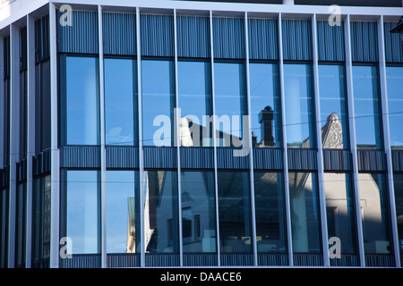 Alesund town reflected on a modern building, re-built in Jugendstil, Art Nouveau style, More and Romsdal, Norway, - Stock Photo