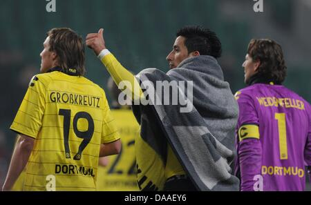Dortmund's player Kevin Grosskreuz (L), Lucas Barrios and goalkeeper Roman Weidenfeller (R) cheer after the Bundesliga - Stock Photo