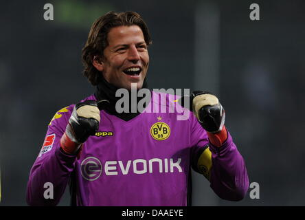 Dortmund's goalkeeper Roman Weidenfeller cheers after the Bundesliga soccer match between VfL Wolfsburg and Borussia - Stock Photo