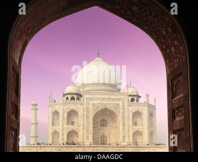 Taj Mahal through arch, Indian Symbol - India travel background. Agra, Uttar Pradesh, India - Stock Photo