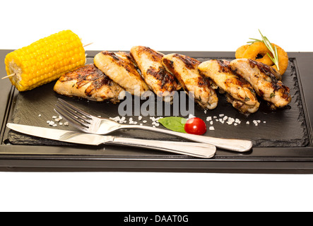 chicken wings and sweet corn cooked on the grill - Stock Photo