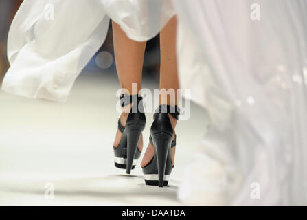 A file picture dated 9 July 2010 shows the feet of a model in high heels during a show of the label Blacky Dress - Stock Photo