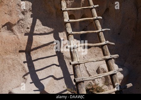 A ladder leading to a prehistoric cliff dwelling in Frijoles Canyon in Bandelier National Monument, New Mexico. - Stock Photo