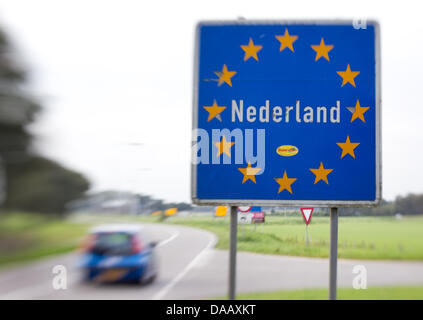 Asign on the border between the Netherlands and Germany reads Nederland (The Netherlands) in Venebrugge, Netherlands, - Stock Photo